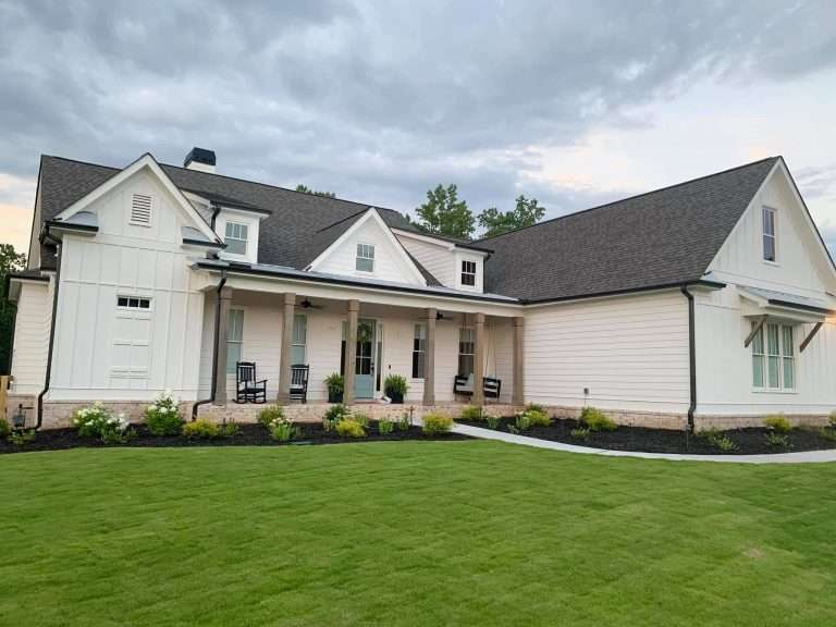large white house with green yard of farm fresh sod