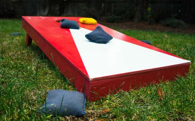 cornhole board on green lawn, enjoying your yard