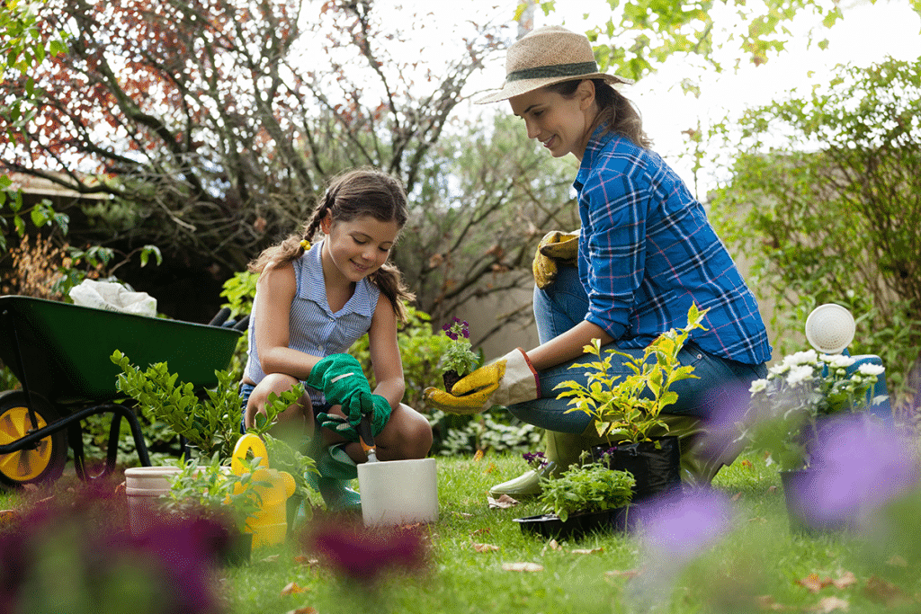 mom and daughter working in yard