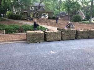 line of zeon zoysia sod pallets delivered outside of a home ready to be installed