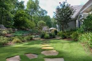 landscaped back yard with zeon zoysia grass