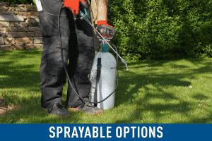 man holding sprayable pre emergent herbicide
