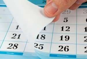 calendar being turned to new month, best time to lay sod concept