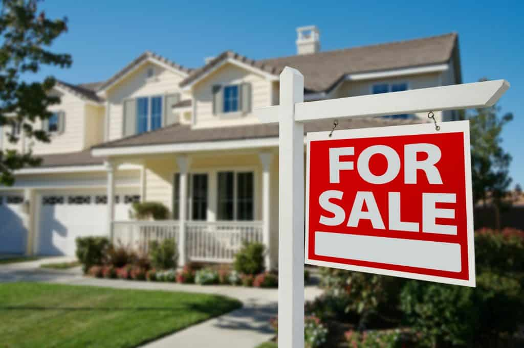home with for sale sign in front, increase in sale of homes following pandemic concept