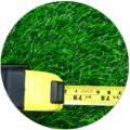 Measuring tape on top of green sod - Sod Calculator