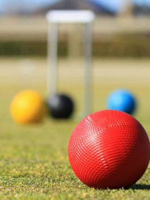 croquet being playing in outdoor lawn